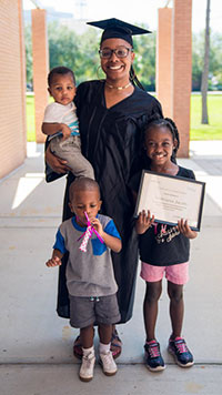 Generation IT student poses with her family at a graduation ceremony in Jacksonville, FL